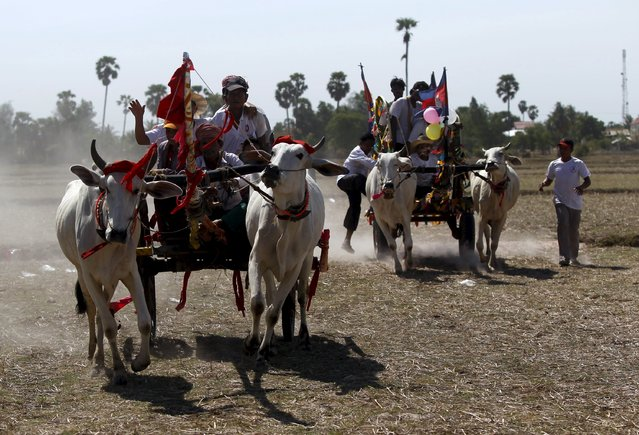 "Villagers take part in the annual ""Lok Ta Pring Ka-Ek"" religious ceremony, on the outskirts of Phnom Penh May 22, 2015. (Photo by Samrang Pring/Reuters)"