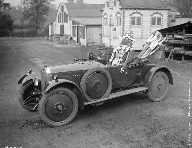 1927: A guy is a passenger in an open car at Messrs Brocks factory and there is a bundle of fireworks in the boot