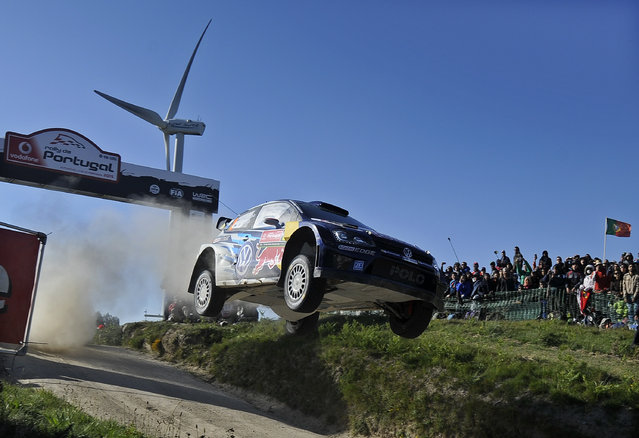 Volkswagen Motorsport driver Jari-Matti Latvala and his co-driver Miikka Anttila, both from Finland, steer their Volkswagen Polo R WRC during the Portugal FIA World Rally Championship Sunday, May 24, 2015 in Lameirinha, Fafe, Portugal. Latvala finished first,  Sebastien Ogier, from France, finished second, and Andreas Mikkelsen, from Norway, finished third. (Photo by Paulo Duarte/AP Photo)