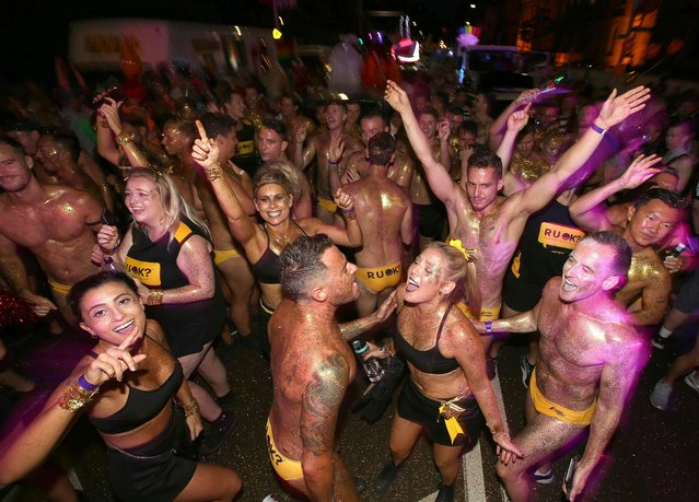 Participants dance before for the annual Gay and Lesbian Mardi Gras parade in Sydney, Saturday, March 4, 2017. (Photo by Rick Rycroft/AP Photo)