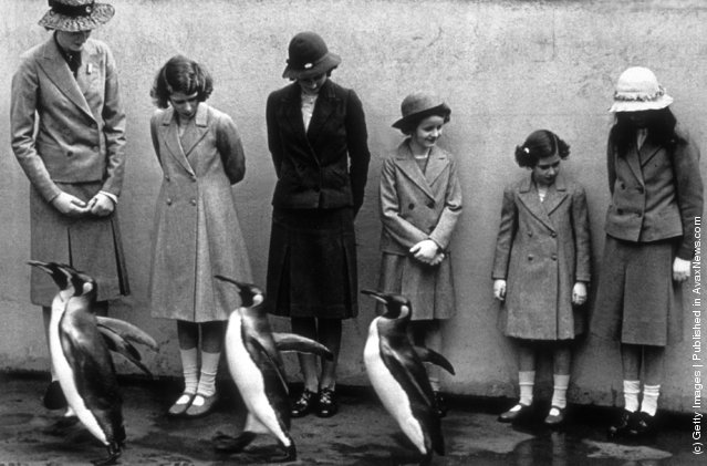 1938: Princesses Elizabeth and Margaret, photographed with the penguins at London Zoo