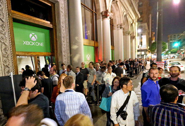 Excited gamers attend the Xbox Media Showcase at E3 in Los Angeles on Monday, June 15, 2015. (Photo by Casey Rodgers/Invision for Microsoft/AP Images)