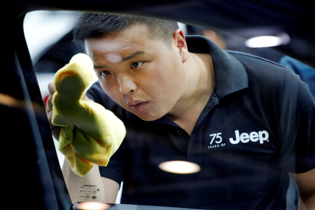 A member of the staff cleans a window of a Jeep vehicle presented during the Auto China 2016 show in Beijing, China April 25, 2016. (Photo by Damir Sagolj/Reuters)
