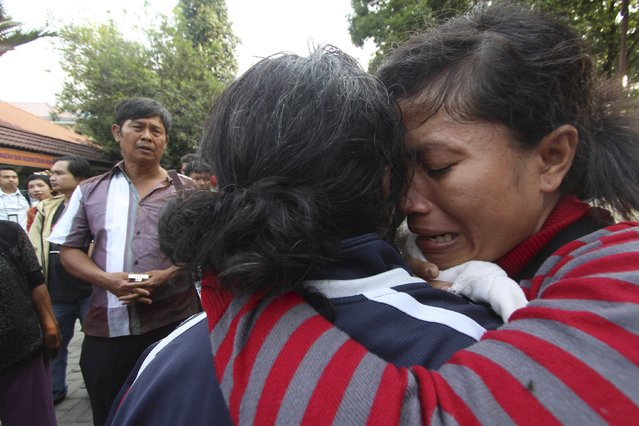 A family member of a victim from an Indonesian military C-130 Hercules transport plane that crashed into a residential area, cries at Adam Malik hospital in the North Sumatra city of Medan, Indonesia, June 30, 2015, in this photo taken by Antara Foto. (Photo by Septianda Perdana/Reuters/Antara Foto)