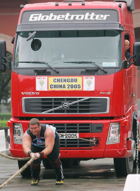 Terry Hollands of Britain drags a truck during a match of the 2005 World's Strongest Man Competition at Wuhou Temple