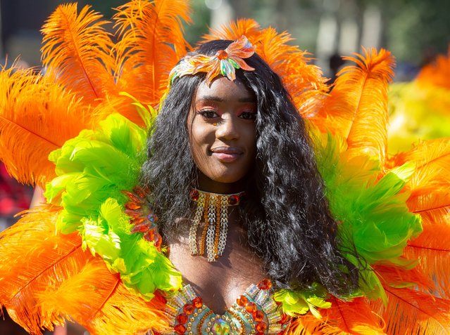Colourful costumes at the Notting Hill Carnival. Performers enjoying the hot weather at the annual procession through the streets of Notting Hill in London, England on August 26, 2019. The Carnival celebrates the different cultures and traditions from the Carribean. (Photo by Mark Thomas/Rex Features/Shutterstock)