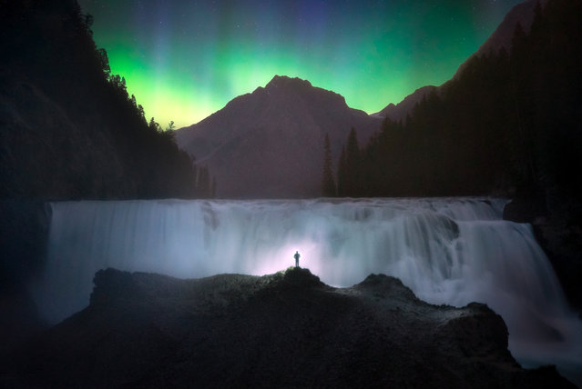 One of Pauls amazing self portraits. at Wapta Falls, Yoho National Park. (Photo by Paul Zizka/Caters News Agency)