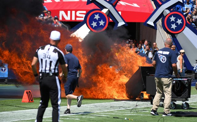 Crews work to put out a fire on the field from pregame pyrotechnics before a game between the Tennessee Titans and Indianapolis Colts in Nashville, September 15, 2019. (Photo by Christopher Hanewinckel/USA TODAY Sports)