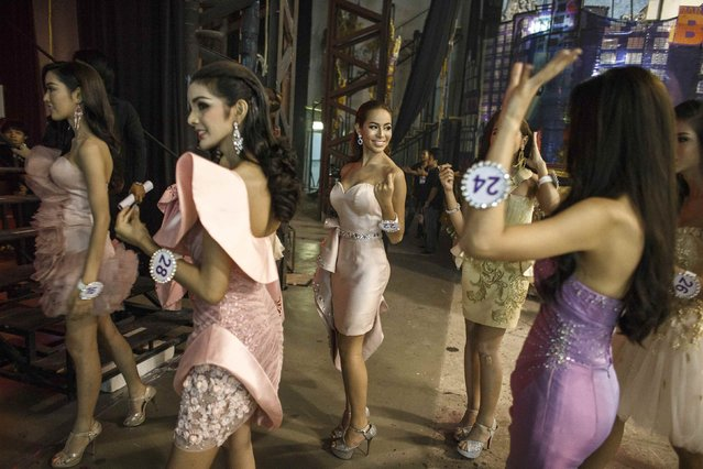 Contestants talk backstage as they wait for the competition to begin. (Photo by Athit Perawongmetha/Reuters)