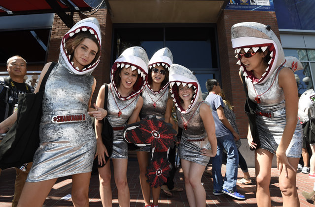 Women promoting Sharknado 3 dance on Fifth Avenue on Preview Night at Comic-Con International held at the San Diego Convention Center Wednesday July 8, 2015 in San Diego. (Photo by Denis Poroy/Invision/AP Photo)