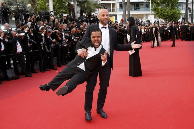 """Franck Gastambide and Anouar Toubali pose on the red carpet as they arrive for the screening of the film """"Money Monster"""" out of competition during the 69th Cannes Film Festival in Cannes, France, May 12, 2016. (Photo by Jean-Paul Pelissier/Reuters)"""
