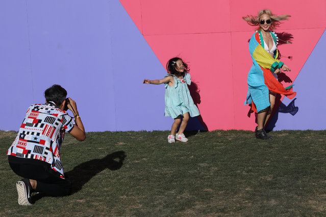 People dance and pose for photos on the opening day of the Coachella Valley Music and Arts Festival on April 15, 2017 in Indio, California. (Photo by Carlo Allegri/Reuters)