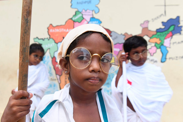 A student dressed like Indian independence icon Mahatma Gandhi, looks on during an event at a school in Chennai on October 2, 2019, to mark Gandhi's 150th birth anniversary. (Photo by Arun Sankar/AFP Photo)