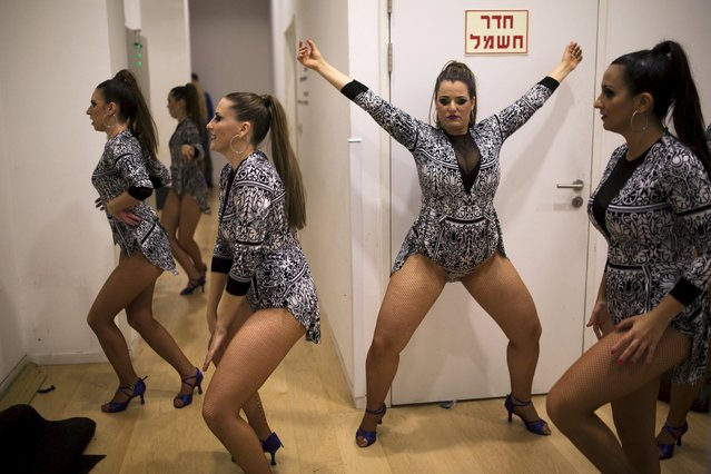 Participants prepare for their performance backstage during a Latin dance competition in Tel Aviv, Israel July 18, 2015. Some 66 dancers took part in the contest on Saturday, selecting a winning couple to represent Israel in the finals of The World Latin Dance Cup, which will be held at the end of the year in Miami. (Photo by Amir Cohen/Reuters)