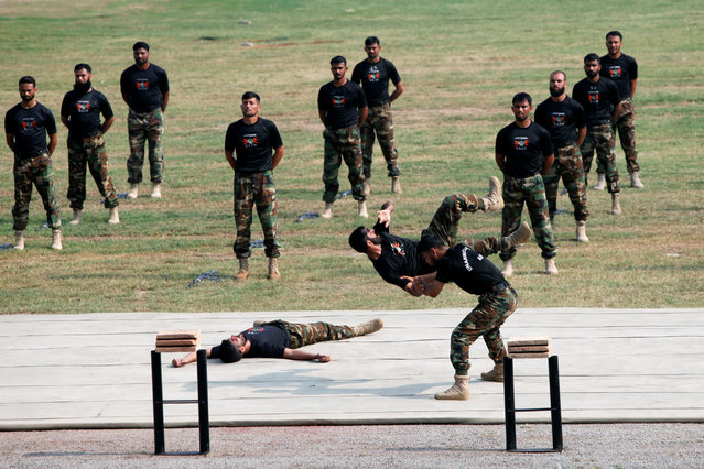 Soldiers practice ahead of the Defence Day, or Pakistan's Memorial Day, in Peshawar, Pakistan on September 5, 2019. (Photo by Khurram Parvez/Reuters)