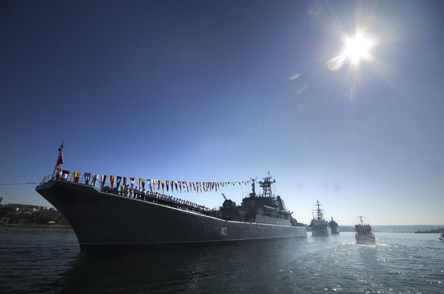 Russian navy battle ships station in the bay during a rehearsal of the Russian Navy Day parade in Sevastopol, Crimea, Friday, July 24, 2015. The Russian Navy Day is celebrated the last Sunday of July. (Photo by Alexander Polegenko/AP Photo)