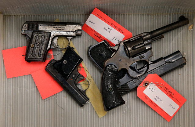 "Handguns turned in from the public as part of the ""Gun Turn-in"" event where a gift card is given for every firearm turned over to Chicago Police are seen in a box at Universal Missionary Baptist Church in Chicago, Illinois, U.S. May 28, 2016. (Photo by Jim Young/Reuters)"