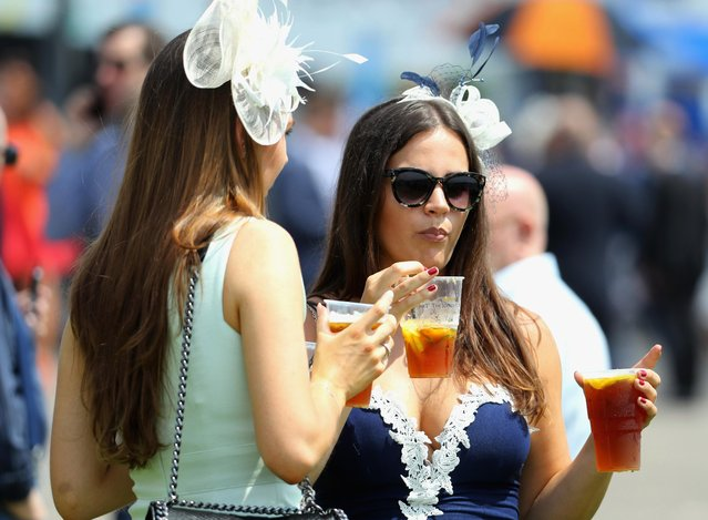 Race goers are pictured during the Investec Ladies Day at Epsom Downs Racecourse on June 2, 2017 in Epsom, England. (Photo by Warren Little/Getty Images)