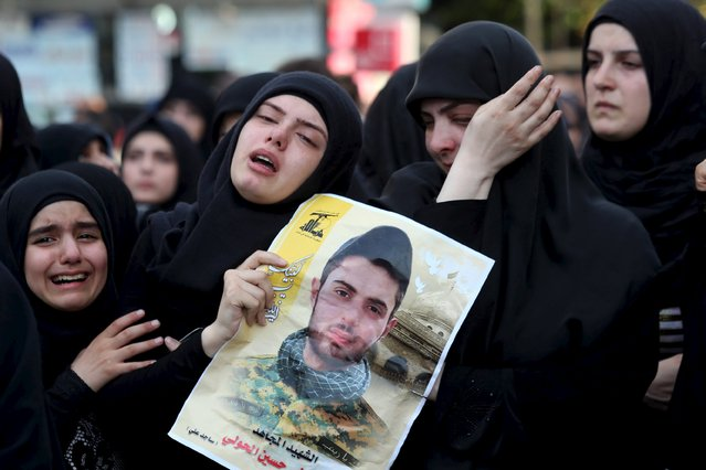 Women react as they mourn the deaths of Hezbollah fighters Mohamad al-Aziz and Mustapha al-Hooli during their funeral in Beirut's southern suburbs July 28, 2015. (Photo by Hasan Shaaban/Reuters)