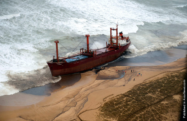 Fuel oil spilled from the stranded TK Bremen covers parts of Kerminihy beach in Erdeven after a storm battered the region on December 16, 2011