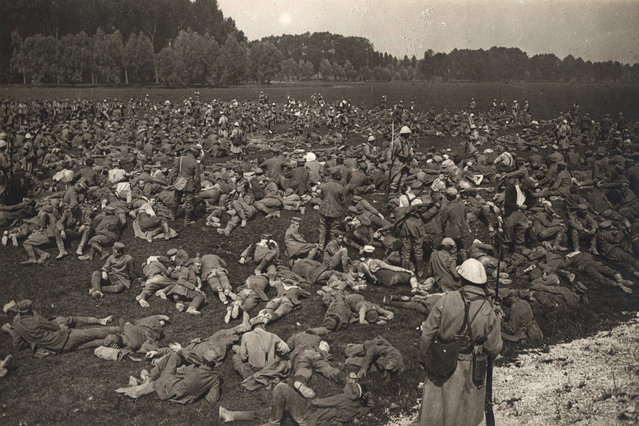 Captured German prisoners lie down in a field at Longueau, on the Western Front, in this August 1, 1916 handout picture. This picture is part of a previously unpublished set of World War One (WWI) images from a private collection. The pictures offer an unusual view of varied and contrasting aspects of the conflict, from high tech artillery to mobile pigeon lofts, and from officers partying in their headquarters to the grim reality of life and death in the trenches. The year 2014 marks the centenary of the start of the war. (Photo by Reuters/Archive of Modern Conflict London)