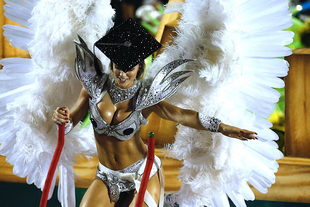 A member of the samba school of the Grupo Especial Academicos do Grande Rio parade during the Carnival celebration at the Marques de Sapucai sambadrome in Rio de Janeiro, Brazil, early 04 March 2019. The samba schools of the Rio de Janeiro Special Groups began their parades on 03 March at the sambadrome, considered the main attraction of the carnival in Brazil. (Photo by Marcelo Chello/EPA/EFE)