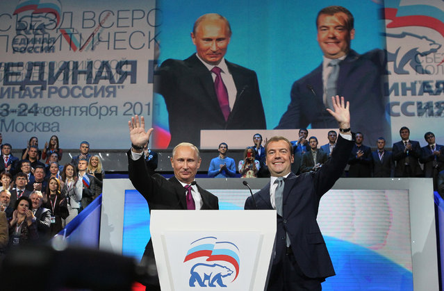 Russian President Dmitry Medvedev, right, and Prime Minister Vladimir Putin wave during a United Russia party congress in Moscow, Saturday, September 24, 2011. Russia's dominant political party on Saturday nominated Vladimir Putin for president, almost certainly ensuring his return to the office he held for eight years, and approved Putin's proposal that current president Dmitry Medvedev swap places and become prime minister. (Photo by Yekaterina Shtukina/AP Photo/RIA Novosti/Presidential Press Service)