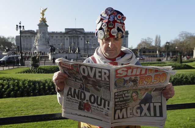 """Self-proclaimed royal super-fan John Loughrey poses for the media backdropped by Buckingham Palace in London, Thursday, January 9, 2020.  In a statement Prince Harry and his wife, Meghan, said they are planning """"to step back"""" as senior members of the royal family and """"work to become financially independent"""". (Photo by Kirsty Wigglesworth/AP Photo)"""