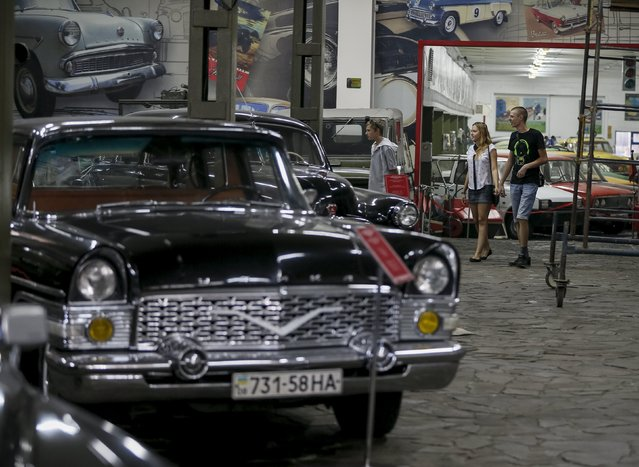 Visitors walk along a car exhibition at Phaeton museum in Zaporizhia, Ukraine, August 11, 2015. (Photo by Gleb Garanich/Reuters)