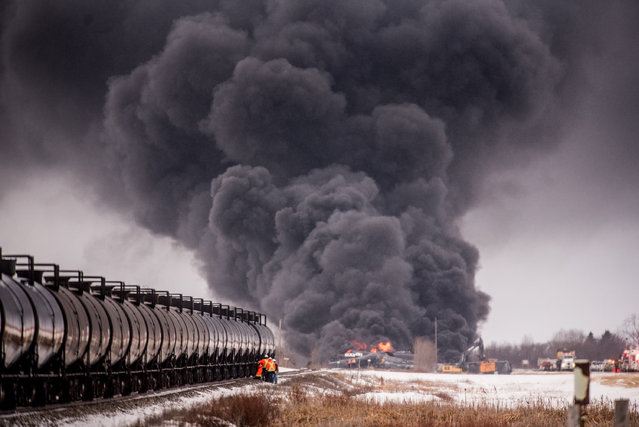 Thick smoke billows from a derailed Canadian Pacific Freight train near Guernsey, Saskatchewan, Canada on February 6, 2020. (Photo by Canadian Press/Rex Features/Shutterstock)