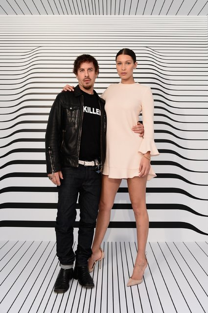 Fashion photographer Steven Klein (L) and model Bella Hadid attend the launch of Samsungs fall Lookbook in celebration of the new Samsung Galaxy S6 edge+ and Galaxy Note5 at the Samsung Galaxy Studio in Soho on August 13, 2015 in New York City. (Photo by Ilya S. Savenok/Getty Images for Samsung)