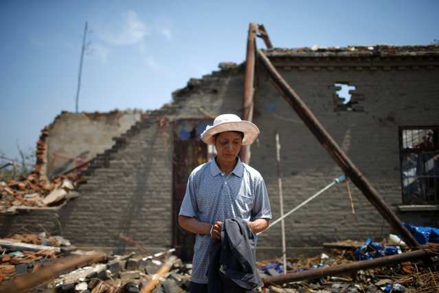 A villager who was injured when a tornado hit Funing on Thursday, is seen at his damaged house in Yancheng, Jiangsu province, China June 25, 2016. (Photo by Aly Song/Reuters)