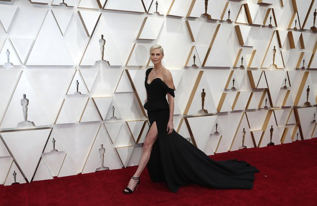 Charlize Theron in Dior and Tiffany & Co. jewelry walks on the red carpet during the Oscars arrivals at the 92nd Academy Awards in Hollywood, Los Angeles, California, U.S., February 9, 2020. (Photo by Eric Gaillard/Reuters)