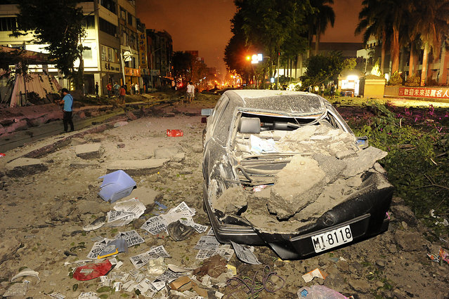 Wreckage of a car is pictured after an explosion in Kaohsiung, southern Taiwan, August 1, 2014. An explosion caused by a gas leak in the southern Taiwanese city Kaohsiung has killed 15 people and injured another 243, Taiwanese media reported on Friday. (Photo by Reuters/Stringer)