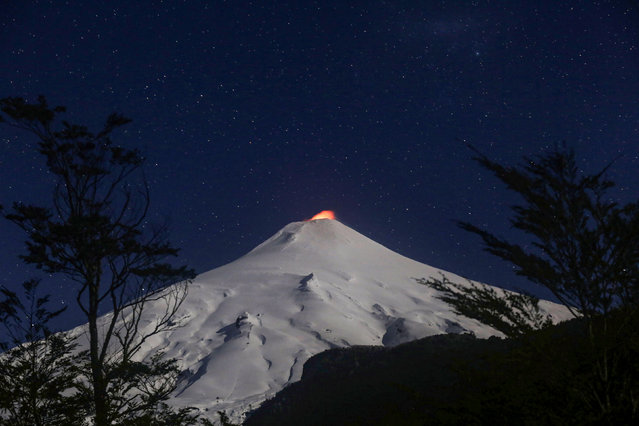 The Villarrica Volcano is seen at night from Pucon town, Chile, August 8, 2019. (Photo by Cristobal Saavedra/Reuters)