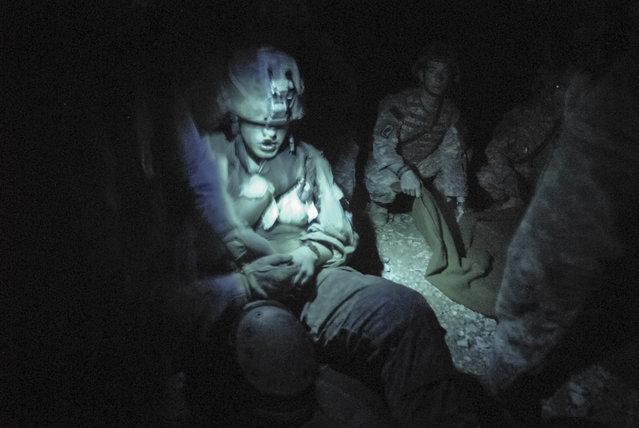 A soldier is treated after being shot in the chest during an ambush. Another soldier was killed during the same ambush. In the wars in Iraq and Afghanistan, army medics and doctors saved an unprecedented 90% of wounded soldiers. (Photo and caption by Van Agtmael/Harrison Jacobs/Magnum Photos)