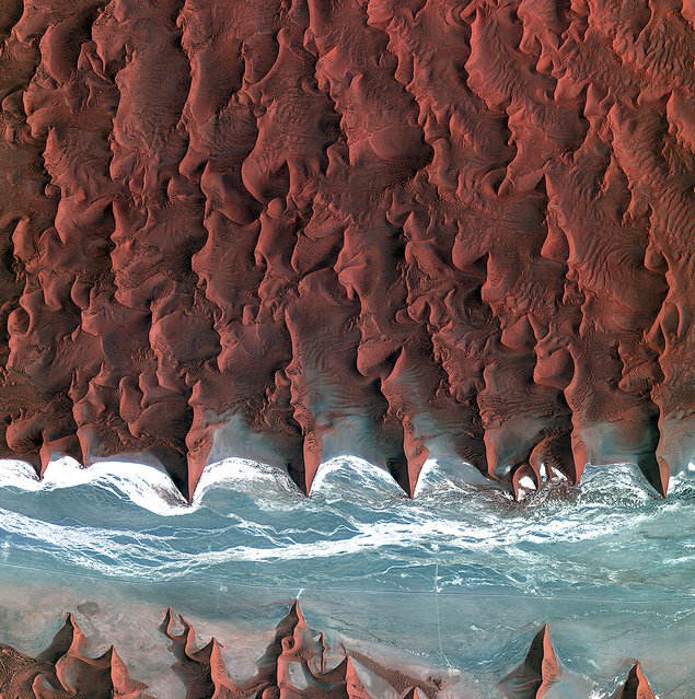 These are the dunes of the Namib Desert, taken by Korea's Kompstat-2 satellite. The blue and white area is the dried riverbed of the Tsauchab river. (Photo by The European Space Agency)