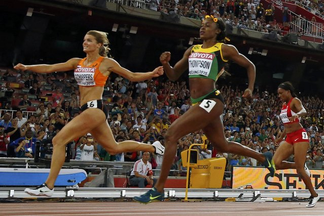 Dafne Schippers of the Netherland (L) runs to win the women's 200m final ahead of Elaine Thompson of Jamaica (C) during the 15th IAAF World Championships at the National Stadium in Beijing, China, August 28, 2015. (Photo by Kai Pfaffenbach/Reuters)