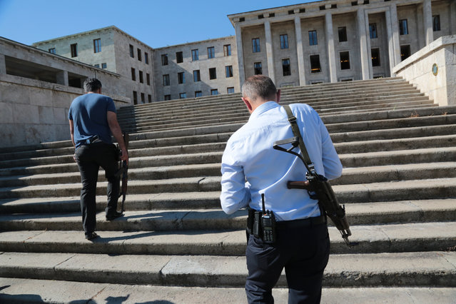 Turkish police officers walk in the grounds of Parliament in Ankara, Turkey, as they secure the building, Saturday, July 16, 2016. (Photo by Burhan Ozbilici/AP Photo)