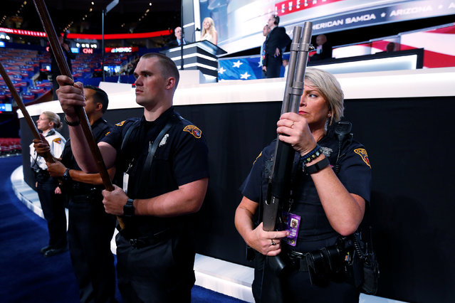 A Cleveland Police honor guard member holds a gun as they practice on the floor at the Republican Convention in Cleveland, U.S., July 19, 2016. (Photo by Carlo Allegri/Reuters)