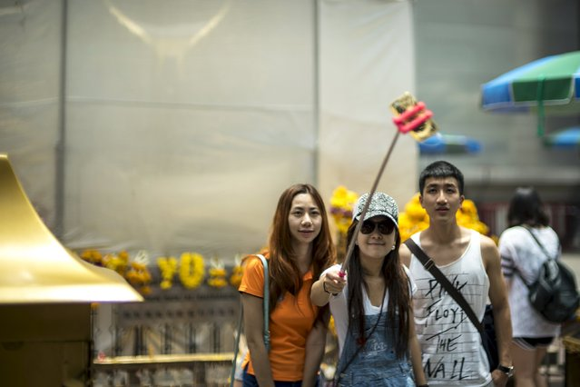 People take a selfie at the Erawan shrine, the site of recent deadly blast, in central Bangkok, Thailand, September 3, 2015. (Photo by Athit Perawongmetha/Reuters)