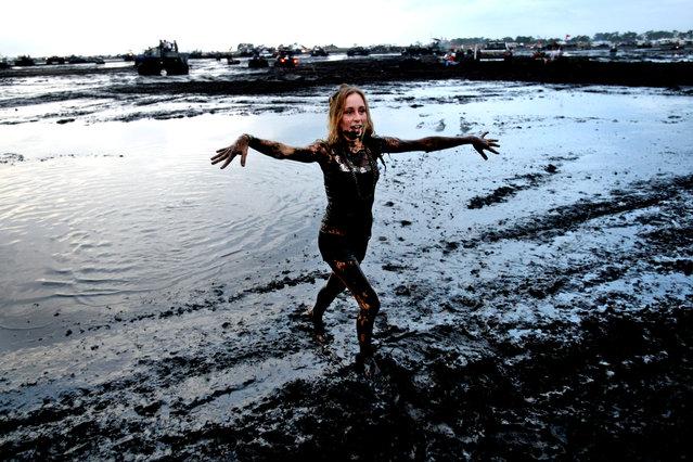 Danielle Piazza of New Smyrna Beach walks out of the mud bug. (Photo by Gary Coronado/The Palm Beach Post)