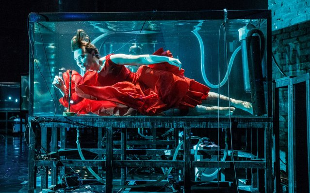 Vocalist Laila Skovmand, a musician with Danish company Between Music, plays underwater in a tank during a rehearsal ahead of their UK premiere concert Aquasonic at the Tramway in Glasgow on Ocrober 25, 2017. (Photo by Robert Perry/PA Images)