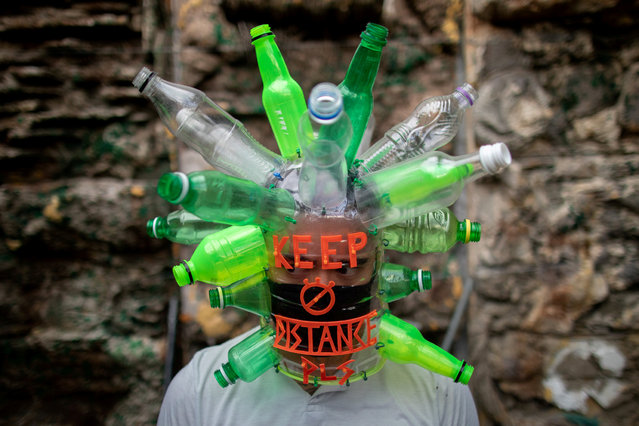 Filipino artist Leeroy New poses with a makeshift mask he designed with recycled materials as he adapts to the effects of the coronavirus disease (COVID-19) pandemic in the art industry, in his studio in Quezon City, Metro Manila, Philippines, May 28, 2020. (Photo by Eloisa Lopez/Reuters)