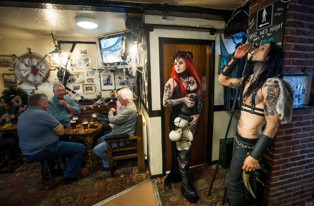 "People in a pub druring the Whitby Goth Weekend in Whitby, Yorkshire, where Bram Stoker found some of his inspiration for ""Dracula"" after staying in the town in 1890 in Whitby, United Kingdom on October 29, 2017. (Photo by Danny Lawson/PA Images via Getty Images)"