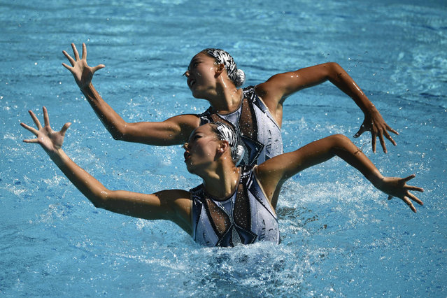 US Anita Alvarez, China's Huang Xuechen and China's Sun Wenyan compete in the Duets Technical Routine preliminaries during the synchronised swimming event at the Maria Lenk Aquatics at the Rio 2016 Olympic Games in Rio de Janeiro on August 15, 2016. (Photo by Martin Bureau/AFP Photo)