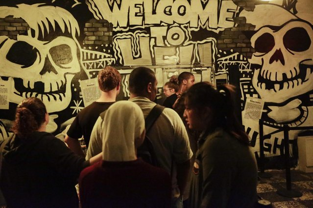 """In this October 2, 2014 photo, patrons line up for  """"Nightmare: New York"""", a haunted house attraction in New York. (Photo by Frank Franklin II/AP Photo)"""