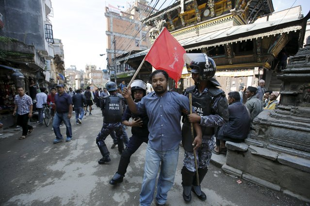 Nepalese riot police personnel detain an opposition supporter protesting against the proposed constitution during a nationwide strike called by the opposition parties in Kathmandu, Nepal September 20, 2015. Nepal will adopt its first full democratic charter on Sunday, a historic step for a nation that has seen war, a palace massacre and devastating earthquakes since a campaign to create a modern state began more than 65 years ago. (Photo by Navesh Chitrakar/Reuters)