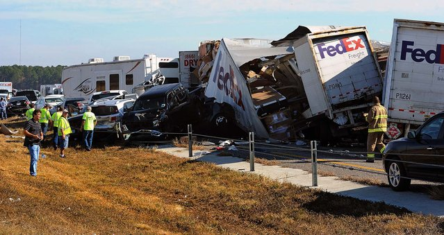 Cars and trucks are piled on Interstate 10 in Southeast Texas, November 22, 2012.  The Texas Department of Public Safety says at least 35 people have been injured in a more than 50-vehicle pileup.  (Photo by Guiseppe Barranco/The Beaumont Enterprise)