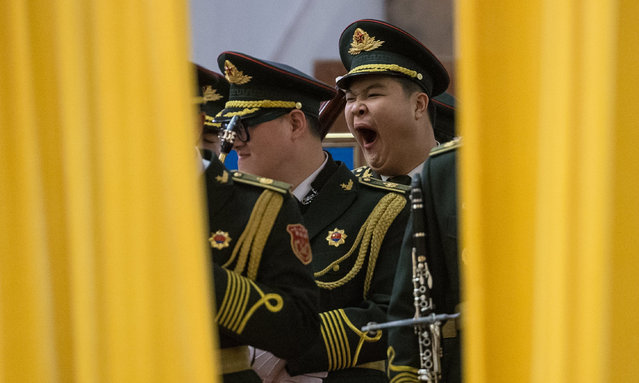 A member of Chinese military orchestra yawns as he waits for the start of a welcome ceremony for President of the Maldives Abdulla Yameen Abdul Gayoom at the Great Hall of the People in Beijing, China, 07 December 2017. President Gayoom is on an official visit to China from 06 to 09 December. (Photo by Roman Pilipey/EPA/EFE)